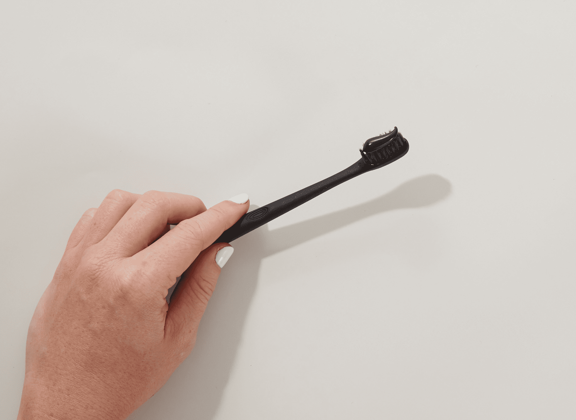 charcoal toothpaste with black brush