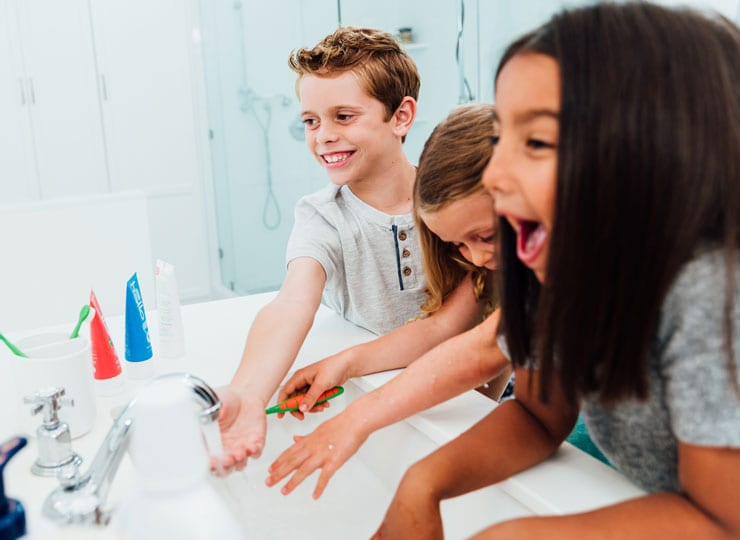 kids brushing with hello toothpaste
