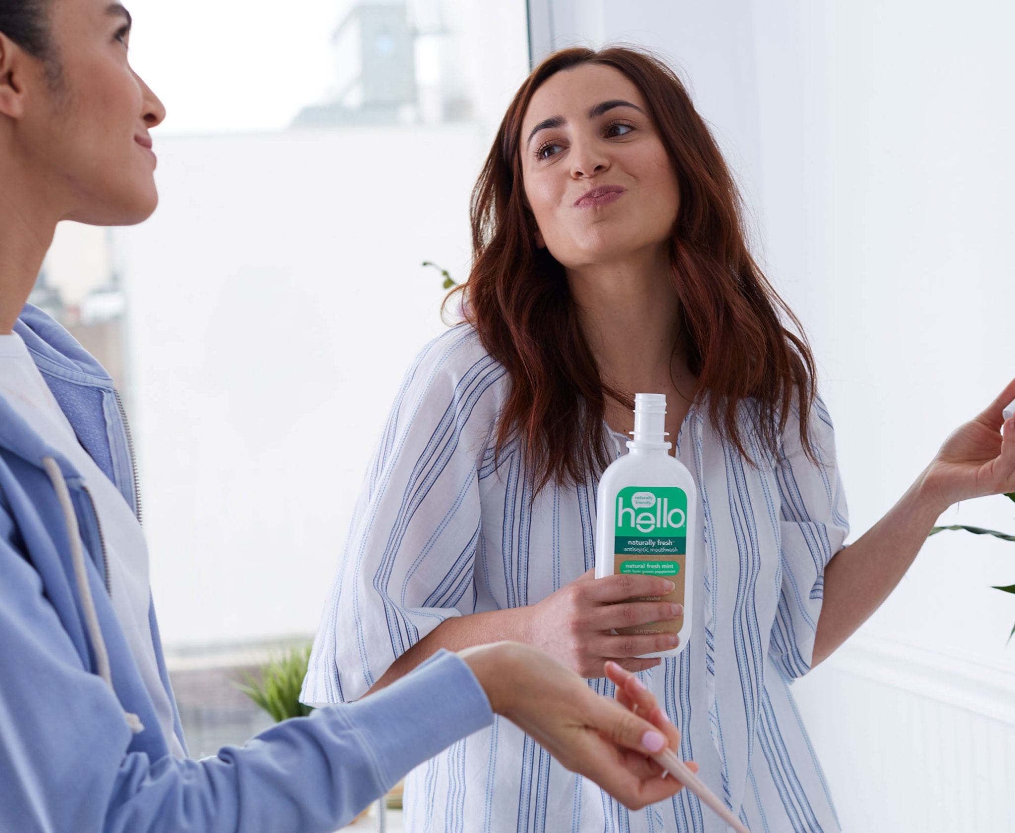women rinsing with naturally fresh mouthwash